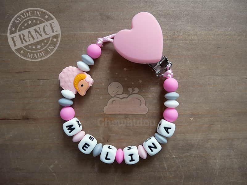 attache sucette pour bébé en silicone mouton rose et gris